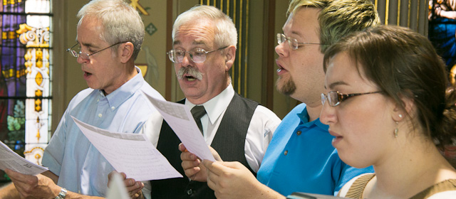 Four Singing Choir Members